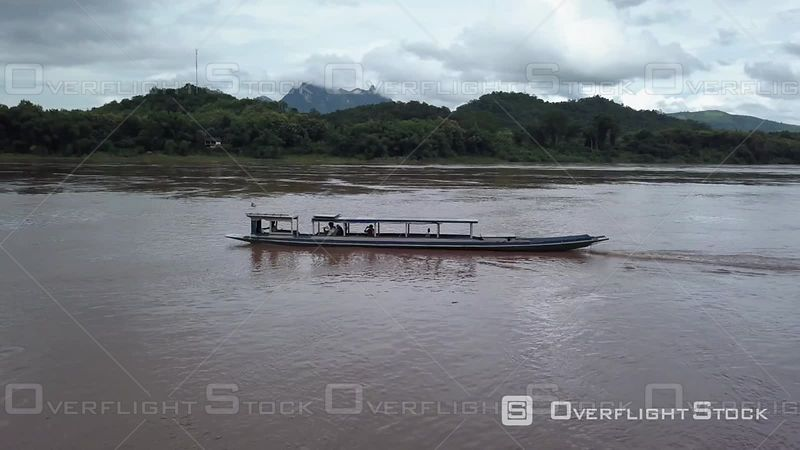Aerial view of a longboat nearby Pak Ou Caves on Mekong river, filmed by drone, Pak Ou, Laos