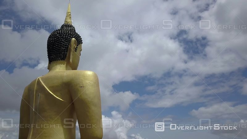 Aerial view of Golden Buddha at Phu Salao temple overlooking the Mekong river and Pakse city, filmed by drone, Pakse, Laos