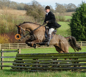 James Collie jumping a hunt jump from the meet
