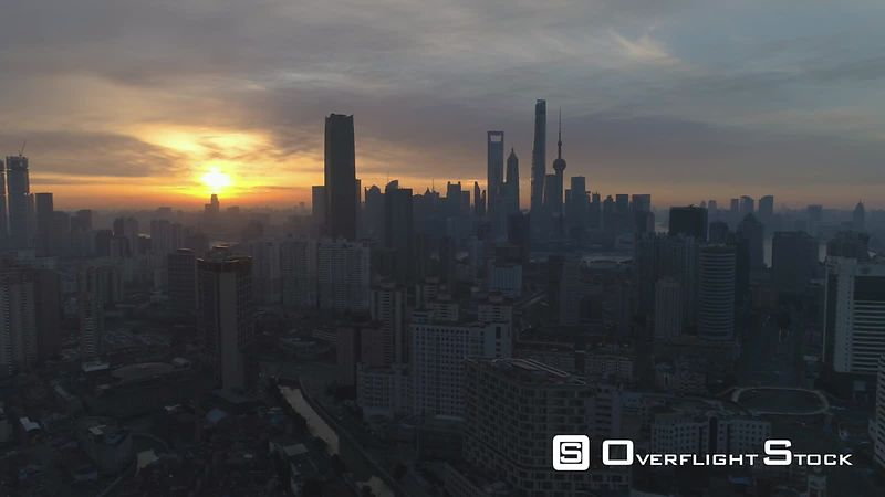 Shanghai Skyline at Sunny Sunrise. Aerial View. China. Drone is Flying Sideways and Downward. Establishing Shot.