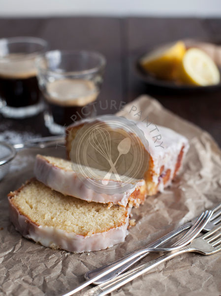 Sliced Lemon Drizzle Loaf Cake with Coffee