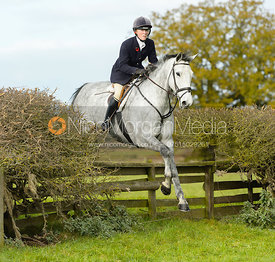 Caroline Edwards jumping a fence near Gartree Covert