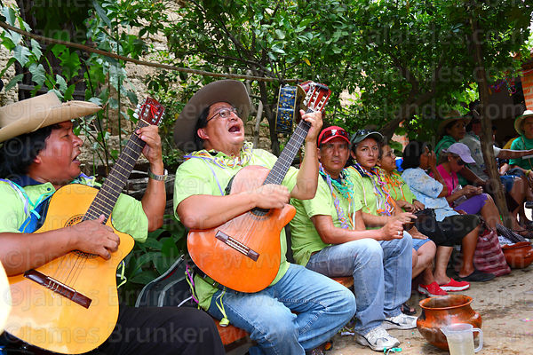 Men playing guitar and singing during carnival, Canasmoro, Tarija Department, Bolivia