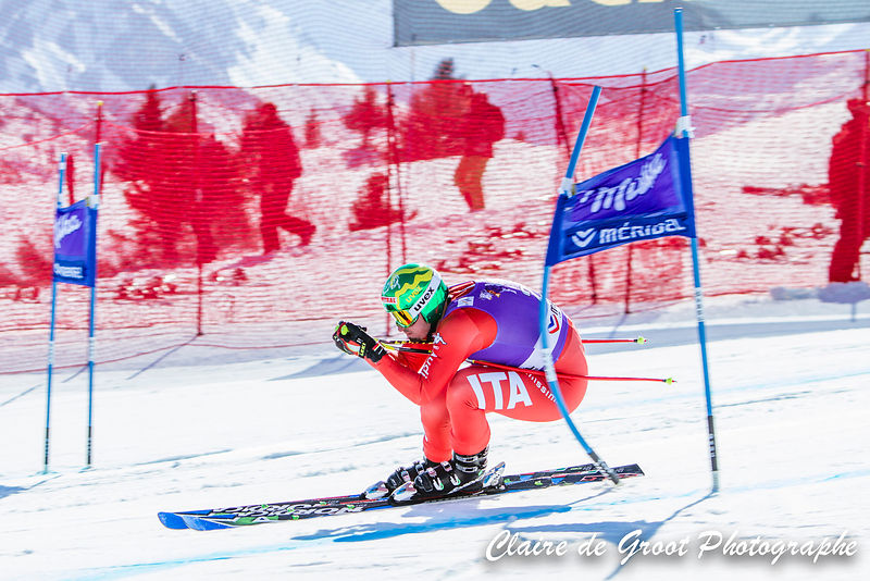 Italian Dominik Paris making contact with the gate in the Super G finals.