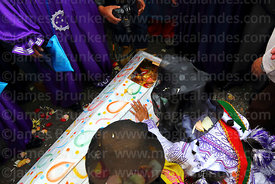 "Mourners say goodbye to the pepino as he is  ""buried"" in his coffin during parades for the Entierro del Pepino, La Paz, Bolivia"