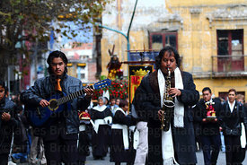 Musicians with brotherhood of Señor de las Caidas / The Fallen Christ during Good Friday procession, Plaza Murillo, La Paz, Bolivia