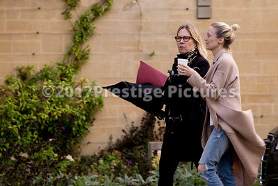 Two Women arriving on set