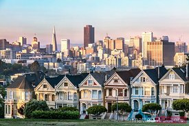 Painted ladies and skyline at sunset, San Francisco, California, USA