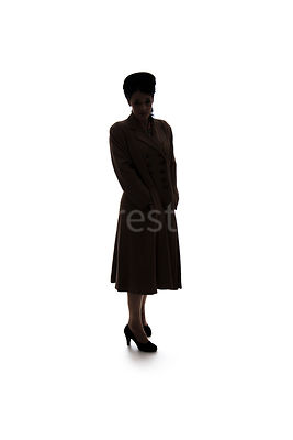 A silhouette of a 1940's mystery woman in a hat and coat – shot from eye-level.