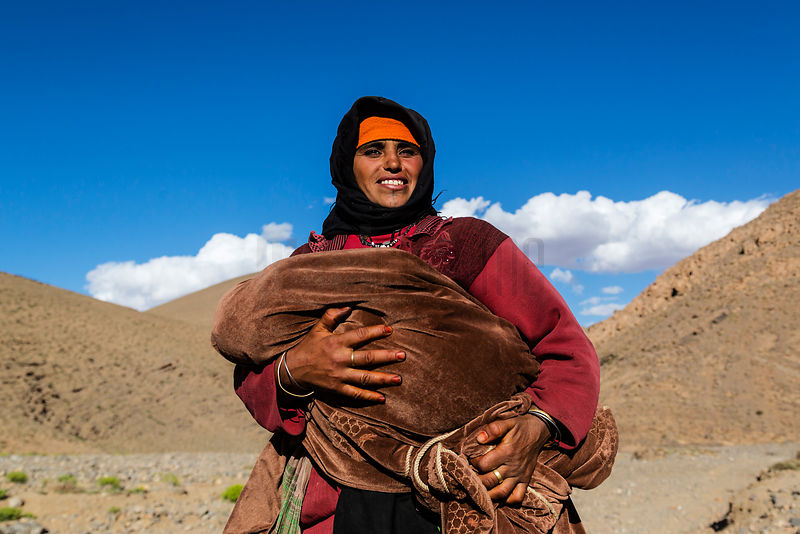 Portrait of a Nomadic Berber Woman Holding her Baby