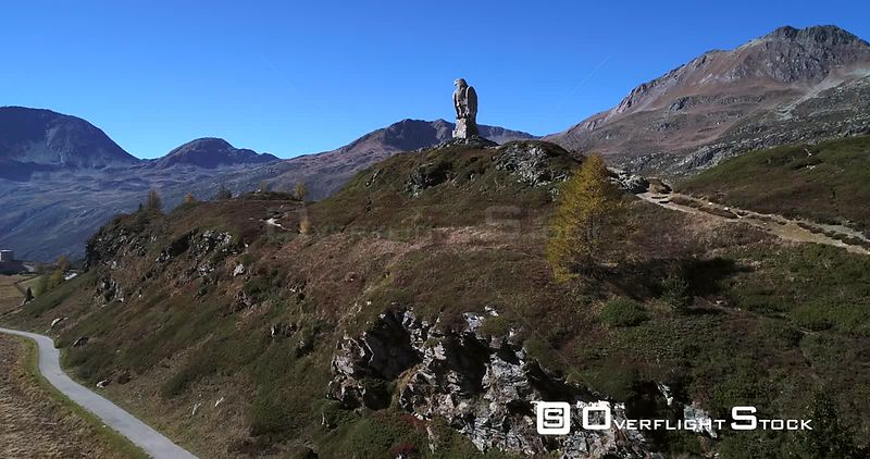 Stone Statue, 4k Aerial View Over a Eagle Statue Monument, on the Top of Simplon Pass, Sunny Autumn Evening, Valais, Switzerland