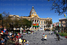 People relaxing in Plaza Murillo, Congress building in background, La Paz, Bolivia