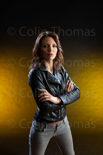 Tough woman in black leather jacket 2 photos