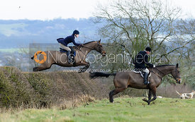 Helen Bowser jumping a hedge above Wilson's covert