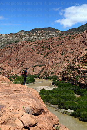 Hiker looking at view along River Tumusla valley near La Palca Grande, Nor Cinti, Chuquisaca Department, Bolivia
