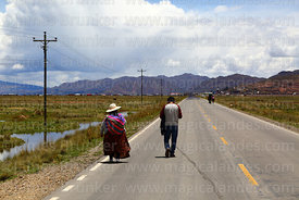 People walking along main road near Desaguadero during a blockade, Puno Region, Peru
