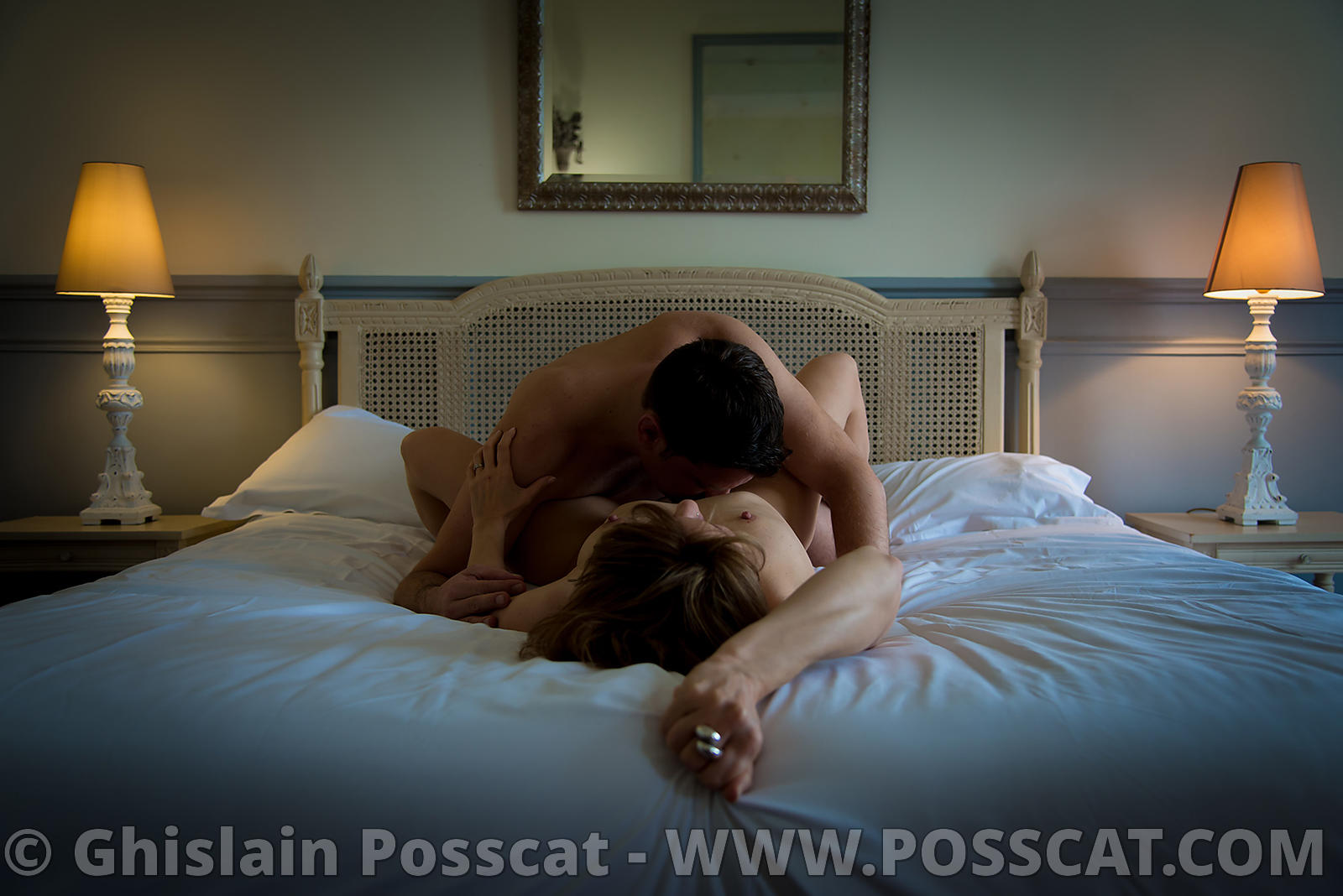 Erotic and nude Photo shooting for couple - man and woman making love on a bed