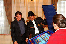 Bolivian president Evo Morales presents American actor Sean Penn with a traditional textile as a gift at the Presidential Palace, La Paz, Bolivia