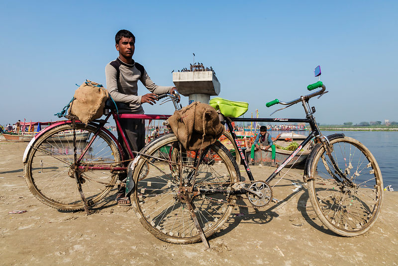 Young Man and Bikes on the Bank of the Yamuna River