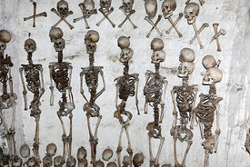 Skulls and skeletons hanging on wall inside tomb of Enrique Torres Belón, church of Santiago the Apostle / Immaculate Conception, Lampa, Peru