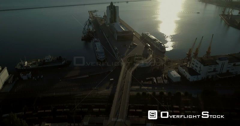 Aerial camera tilts up from the Potemkin Steps to reveal the port of Odessa Ukraine. Taken at dawn in 4K original