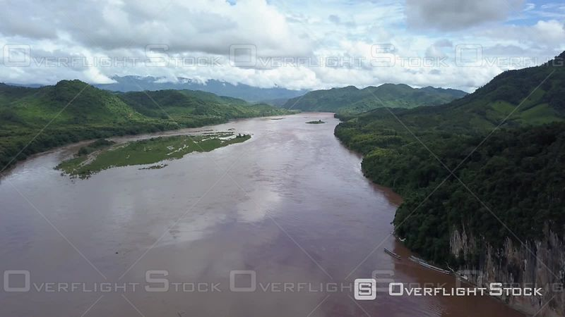 Aerial view of the Pak Ou Caves and village on Mekong river, filmed by drone, Pak Ou, Laos