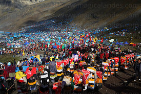 Ukukus (spiritual leaders representing mythical beings)  descending from glaciers after performing overnight rituals to mountain spirits during Qoyllur Riti festival, Peru