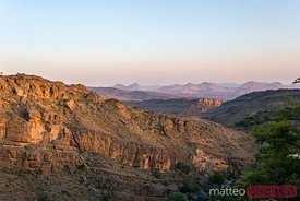 Western Hajar mountains, valley at sunset, Oman