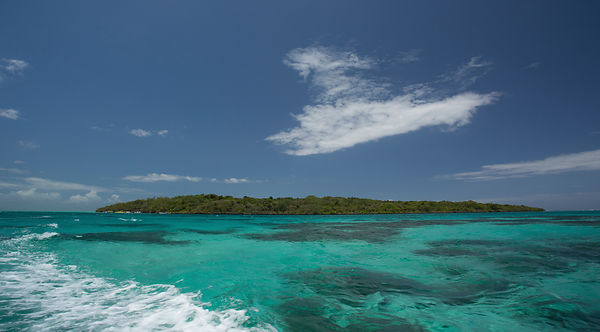 Travelling to the island of Ile aux Aigrettes across the crystal clear Indian Ocean revealing coral reef below