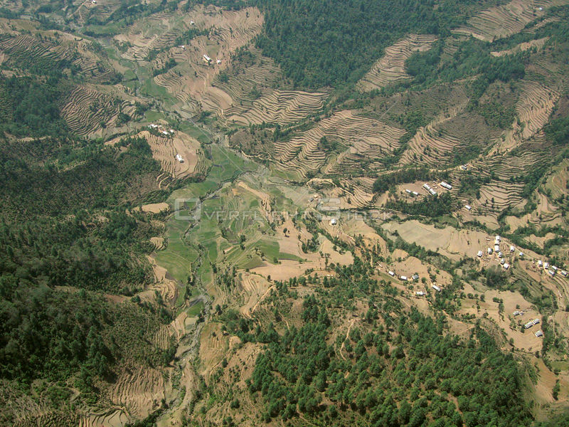 NEPAL Nr Jiri -- 16 Apr 2005 -- Aerial photo of terraced farmland near Jiri. Scientists have warned that rising temperatures from global warming may cause the demise of the Himalayan ice falls and glaciers.
