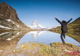 Hiker jumping toward the Matterhorn, Riffelsee, Switzerland