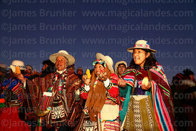 Aymara leaders holding maize and potatos as offerings during Aymara New Year celebrations, Tiwanaku, Bolivia