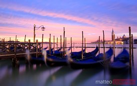 Gondolas at sunrise Venice Italy