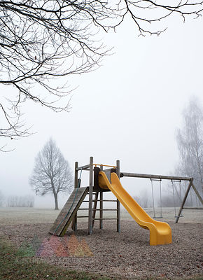 Austria, Mondsee, Autumn fog in park, playground