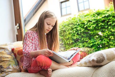 Girl reading on a couch