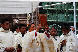Bishop of Puno Jorge Carrion Pablisch holding up bible after reading from it during central mass, Virgen de la Candelaria festival, Puno, Peru