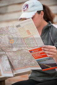 Female reading Ordnance Survey map
