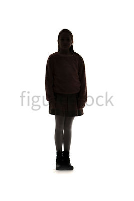 A Figurestock image of a girl in silhouette, standing, looking forward – shot from mid level.