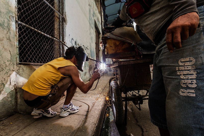 Mechanic Welding a Broken Bicitaxi