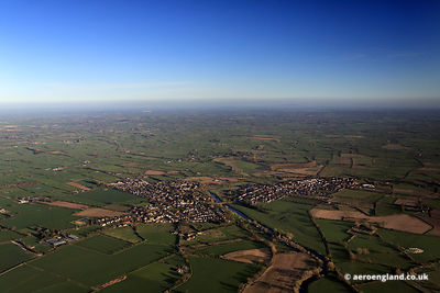 aerial photograph of the river Dee marking the border between England and Wales as it flows between the villages of Farndon in England and Holt in Wales.