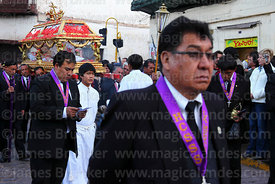 Member of the Brotherhood of Knights of the Lord of the Holy Sepulchre in front of Santo Sepulcro / Crucified Christ during Good Friday procession , Cusco , Peru