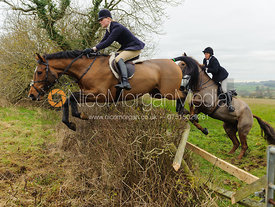 Gaby Cooke jumping at Mrs Wilson's covert - The Cottesmore Hunt at Ranksboro, 26-11-13.