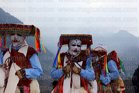 Masked Kapac Qolla dancers on a foggy morning in the mountains during Qoyllur Riti festival, Peru