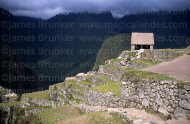 Stormy light over the Watchmans Hut and Urubamba canyon, Machu Picchu, Peru