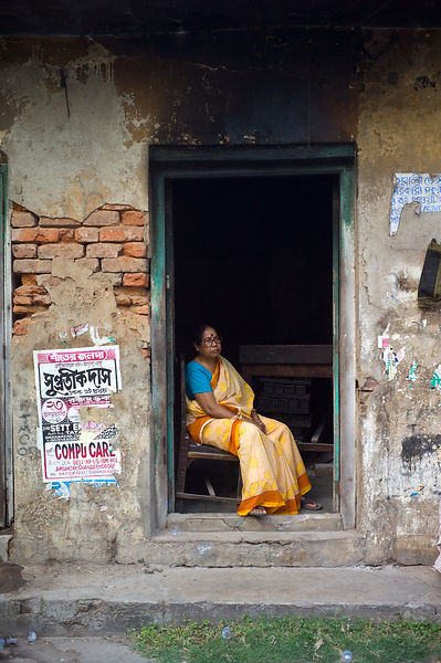 India - Chandannagar - An old woman in the doorway of a house