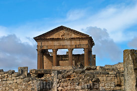 The Capitol at Dougga towering over the ancient roman houses; Tunisia; Landscape