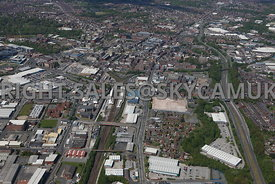 Bolton high level aerial view looking from the south up the main railway line into Bolton Railway Station and Bolton town centre