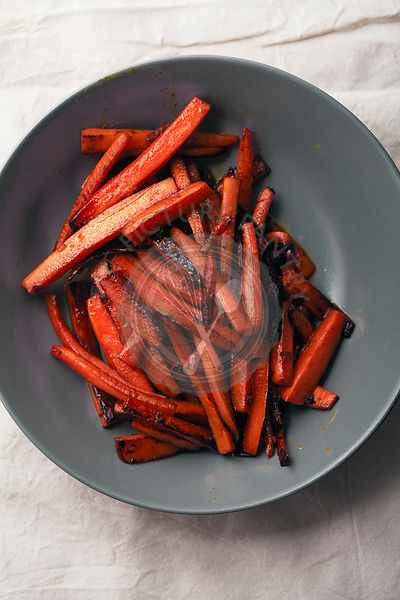 Roasted caramelized carrot slices with olive oil and honey sauce