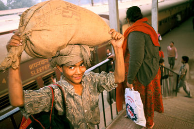 India - Delhi - A child porter at New Delhi Railway station