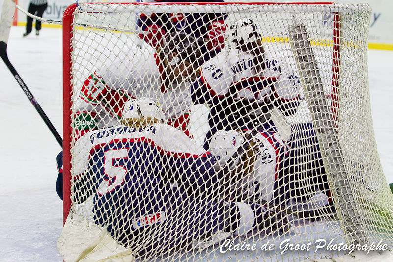 How many hockey players can you fit in the net? At least 5 it turns out.